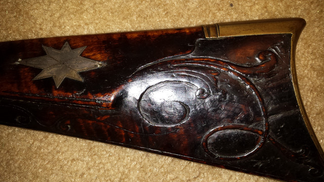 Relief carved kentucky rifle by abraham schweitzer