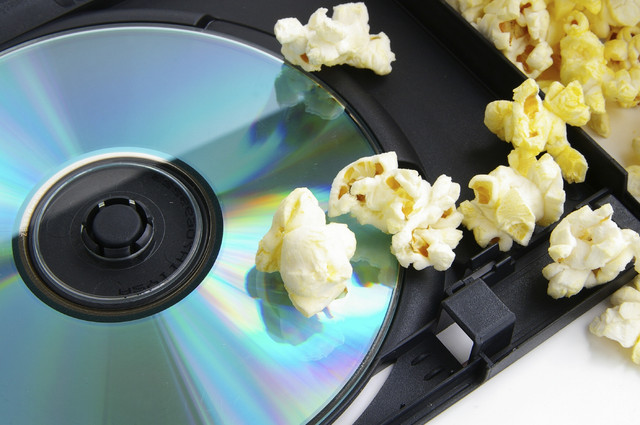 A DVD transferred from VHS surrounded by popcorn