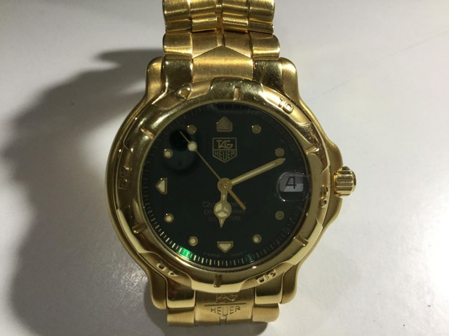 Mint Condition Tag Huer 18 K Solid Gold Watch 60000