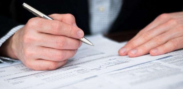 Businessman filling out a form