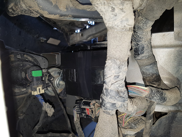 Jeep Compass Relay Box location - view from the driver's side wheel well